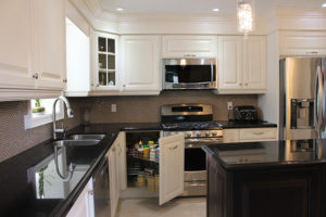 white painted kitchen with magic corner pull out