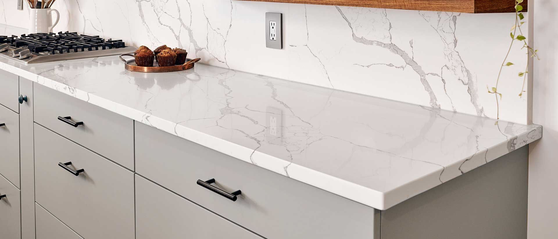 Modern counter top and back splash. Calacatta Quartz ...