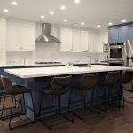 High end kitchen remodeling in Toronto Two tone modern kitchen cabinets. White and blue painted MDF cabinets White quartz countertop and back splash Conestructed in