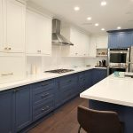 Kitchen renovation downtown Toronto White and blue custom made cabients custom installation two tone painted kitchen cabients European hardware Design and built by Joseph kitchen