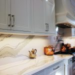 Kitchen design and renovation. Luxury painted white kitchen. Custom design framed kitchen cabinets. Bell shape custom made insert hood. white and gray from marble collection- Britannica from Cambria. North York. 2019